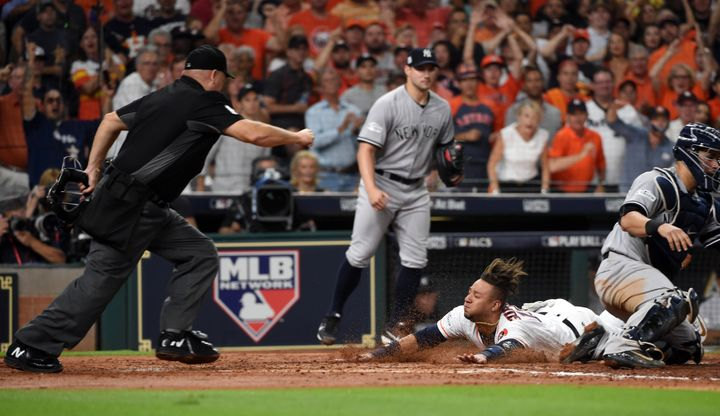 Yuli Gurriel #10 of the Houston Astros slides home to score on the two-RBI double hit by Brian McCann #16 in the fifth inning