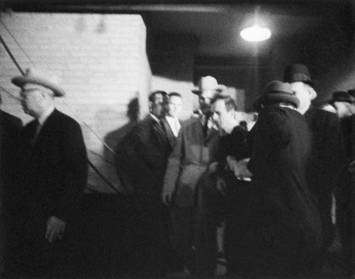 Jack Ruby walks up to accused presidential assassin Lee Harvey Oswald and shoots him as he is escorted into a police station in Dallas.