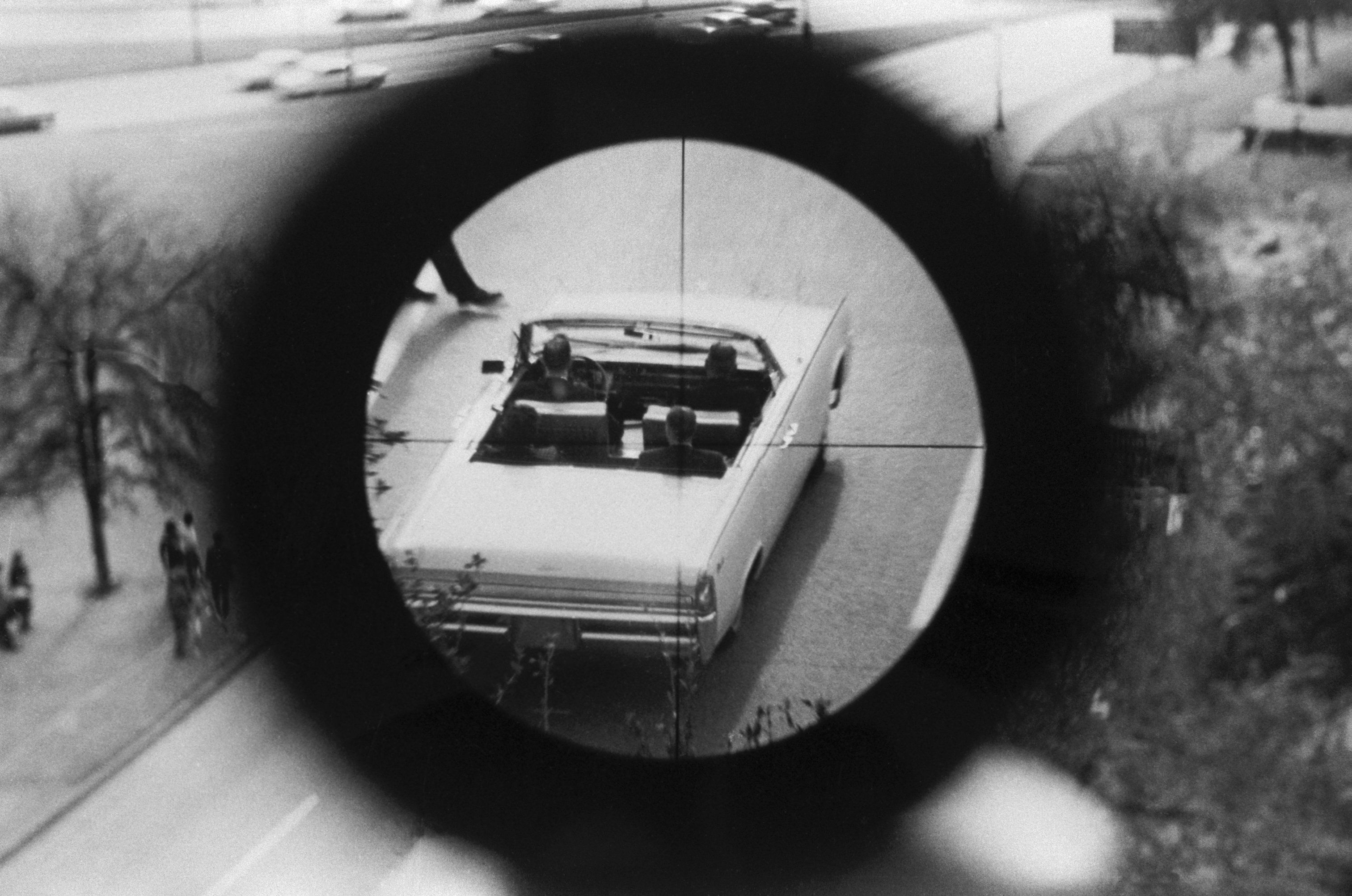 A view through a gun sight from the Texas School Book Depository is part of a reenactment of the Kennedy...