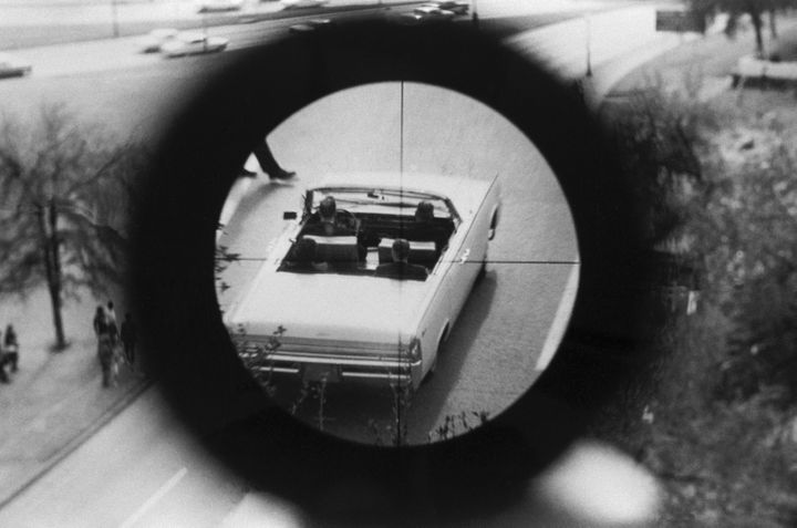 A view through a gun sight from the Texas School Book Depository is part of a reenactment of the Kennedy assassination. This evidence was submitted to the Warren Commission.
