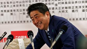 Japan's Prime Minister Shinzo Abe, leader of the Liberal Democratic Party (LDP), smiles during a news conference after Japan's lower house election, at the LDP headquarters in Tokyo, Japan October 22, 2017. REUTERS/Kim Kyung-Hoon