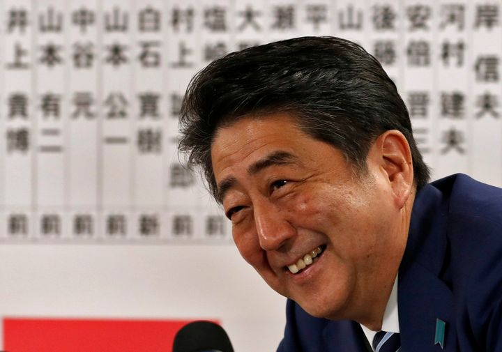 Japan's Prime Minister Shinzo Abe, leader of the Liberal Democratic Party (LDP), smiles during a news conference after Japan'