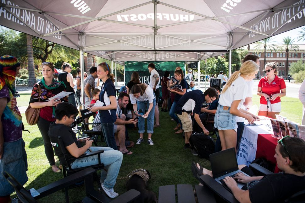"People visit the ""Listen to America"" tents during HuffPost's visit to University of Arizona in Tucson."