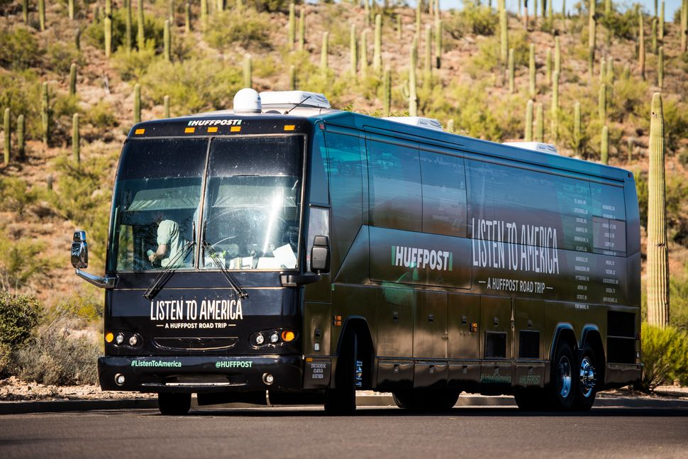 "The HuffPost bus sits amid cacti during HuffPost's visit to Tucson, Arizona, on Oct. 20 as part of ""Listen To America: A Huff"