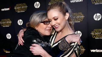 """Actresses Carrie Fisher (L) and Billie Lourd embrace as they arrive at the premiere of """"Star Wars: The Force Awakens"""" in Hollywood, California December 14, 2015.  REUTERS/Mario Anzuoni"""