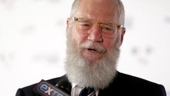 Comedian David Letterman speaks to the media as he arrives for a gala where he is receiving the Mark Twain Prize for American Humor at Kennedy Center in Washington, U.S., October 22, 2017.   REUTERS/Joshua Roberts