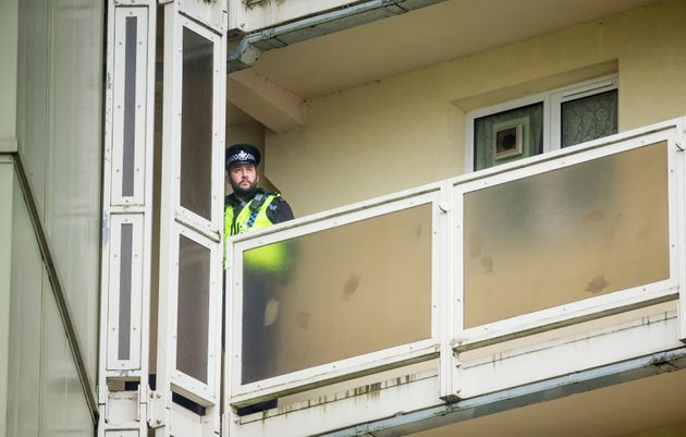 A police officer on a balcony at Newcastle House in Bradford, where 18-month-oldElliot Procterdied...