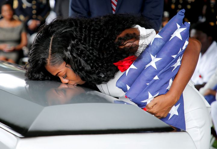 Johnson kisses her late husband's coffin at a graveside servicein Hollywood, Florida, October 21, 2017.