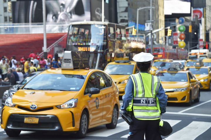 A police officer controls the traffic in Times Square, downtown Manhattan.