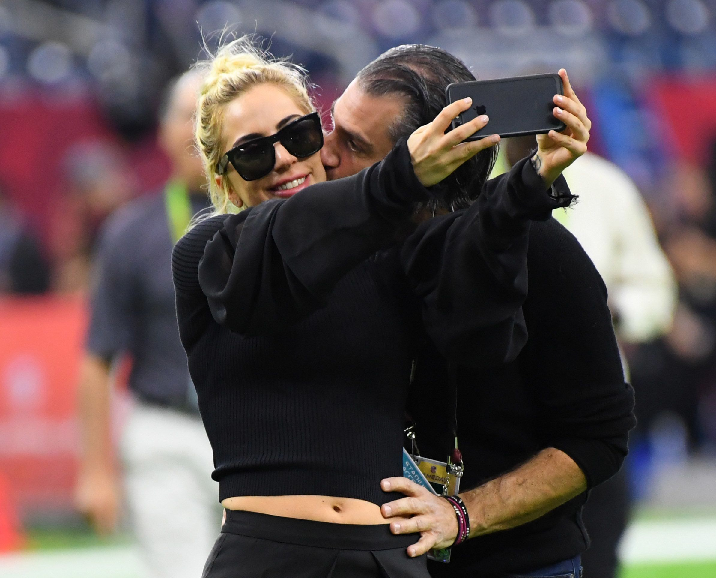 Lady Gaga gets a kiss from Christian Carino before Super Bowl LI.