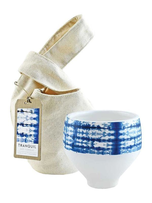 """Get it <a href=""""https://www.gilt.com/brand/northern-lights/product/1184699592-northern-lights-tranquil-shibori-candle-12-oz"""""""