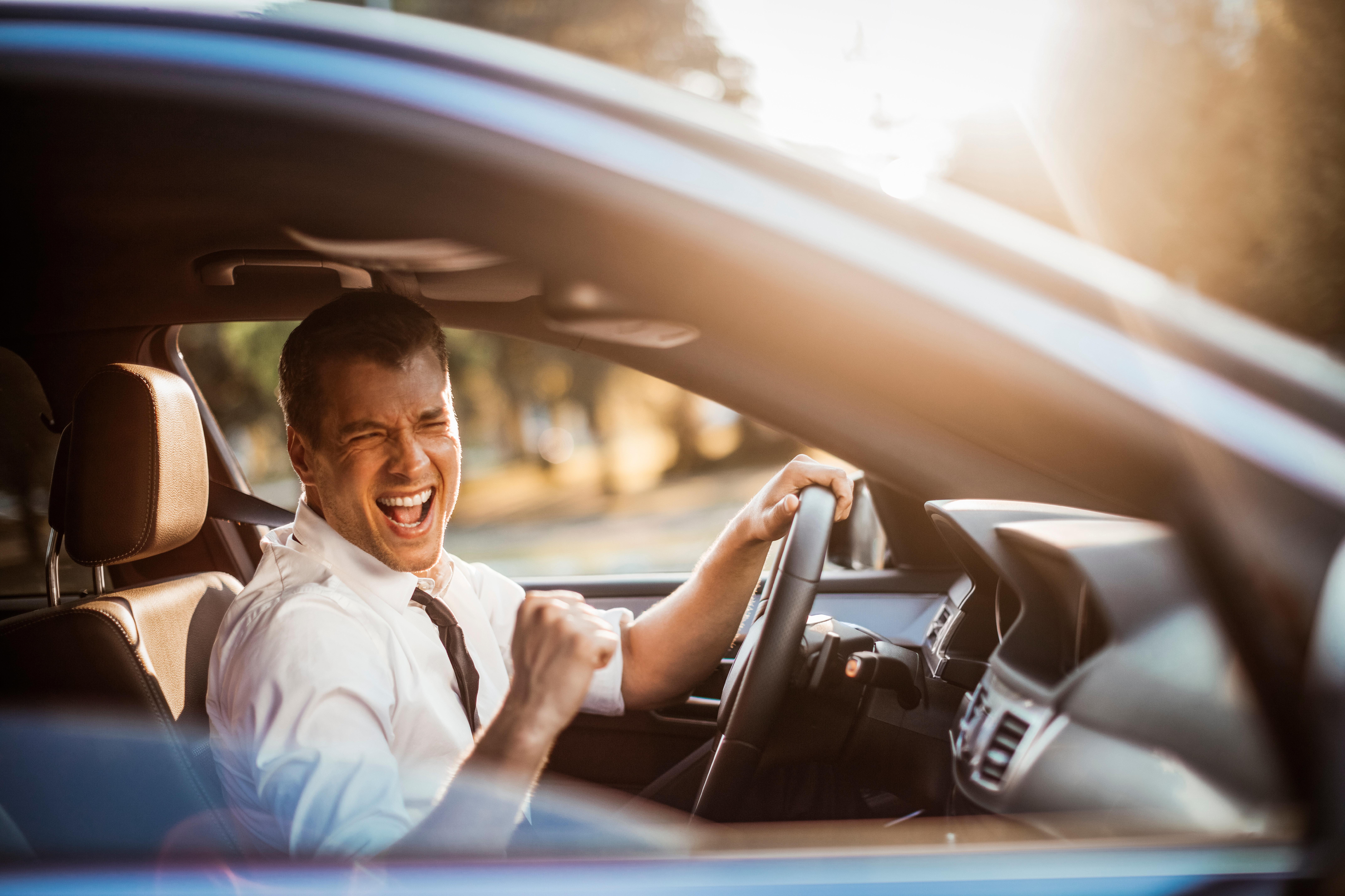 Close up photo of a businessman driving a car