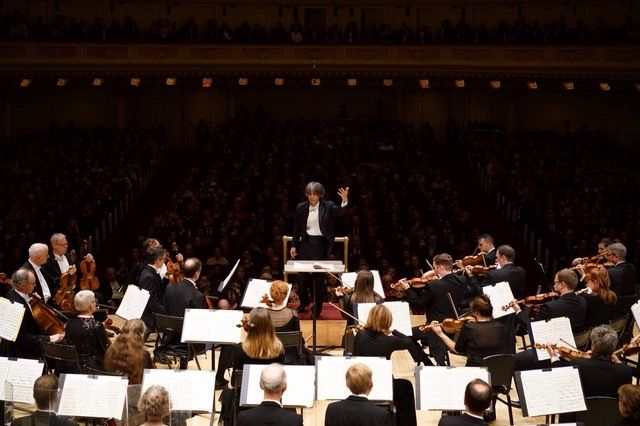 Music Director and Conductor Kent Nagano conducting the Orchestre symphonique de Montréal in concert at Carnegie Hall.