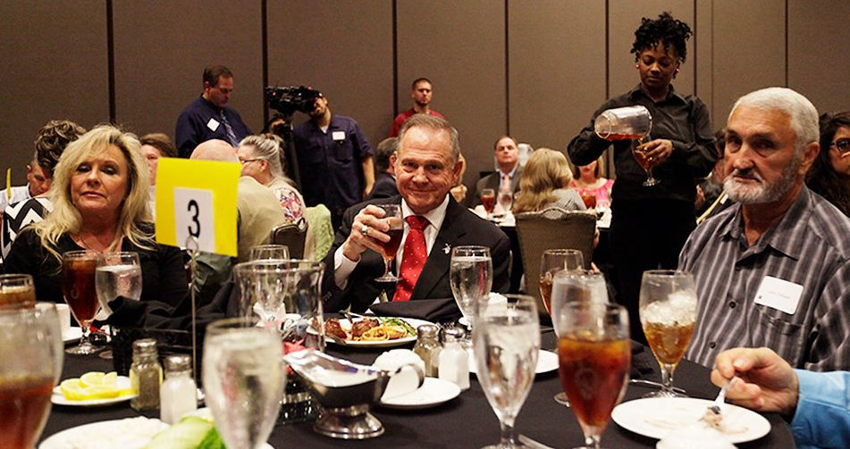 """Judge Roy Moore smiles during an event in Alabama titled """"Freedom Gala: A Celebration of Freedom."""" Even there, Alabamians didn't seem to like him."""