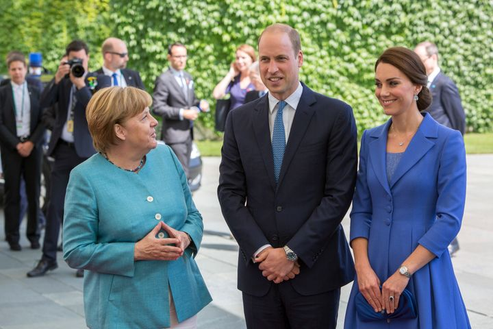 German Chancellor Angela Merkel welcomes Prince William, Duke of Cambridge and Catherine, the Duchess of Cambridge in the Ger