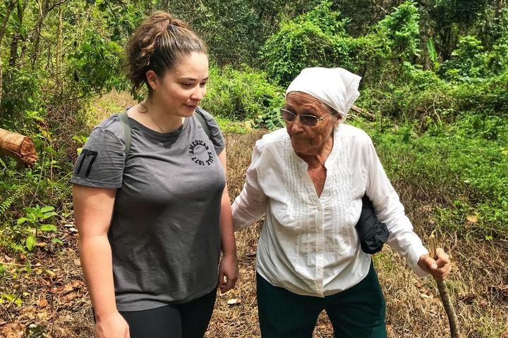 Megan Vazquez and her grandmother, Mercedes Mercado, survey the damage from Hurricane Maria to Mercados farm in Hatillo Puert