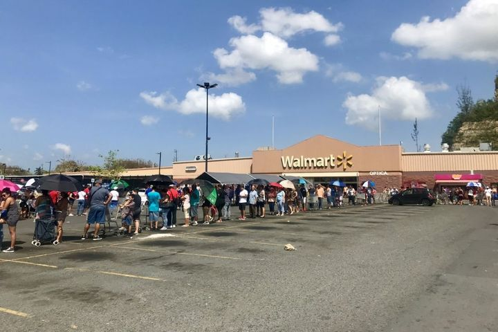 Hundreds of people wait in line for hours at the Walmart in Bayamon Puerto Rico on Oct 8, 2017.