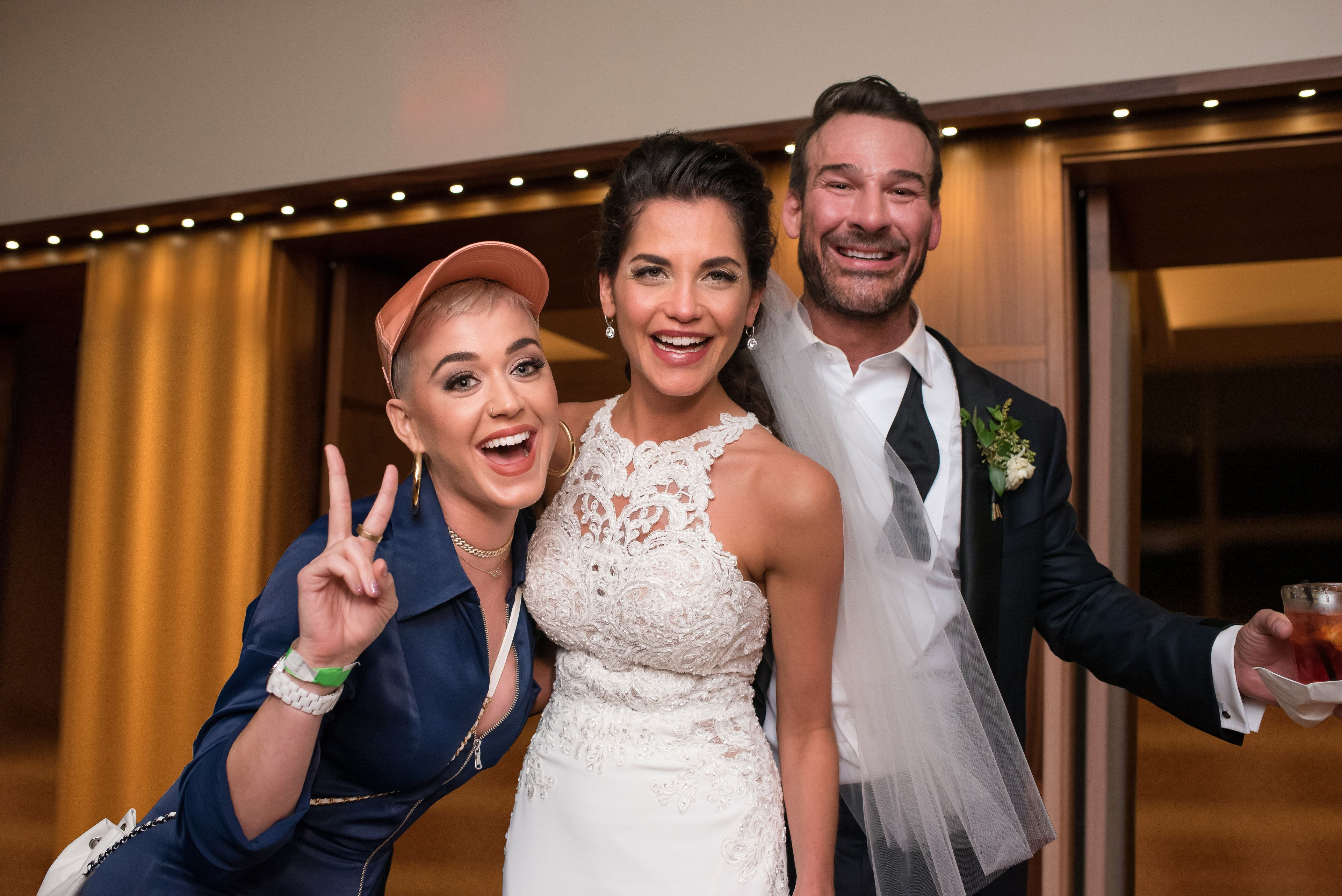 The bride and groom pose with Katy Perry herself.