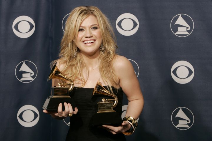 """Kelly Clarkson poses with the two Grammy awards she won for her album """"Breakaway."""""""