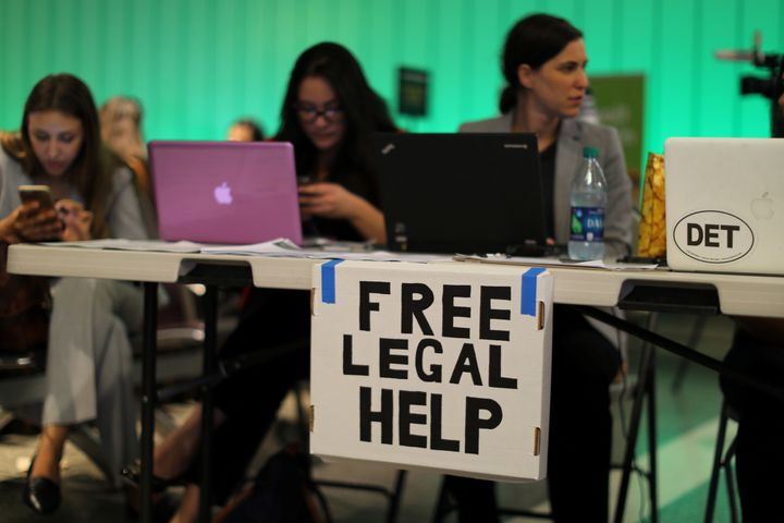 At Los Angeles International Airport on June 29, volunteer lawyers set up a table to help arriving passengers affected by Tru