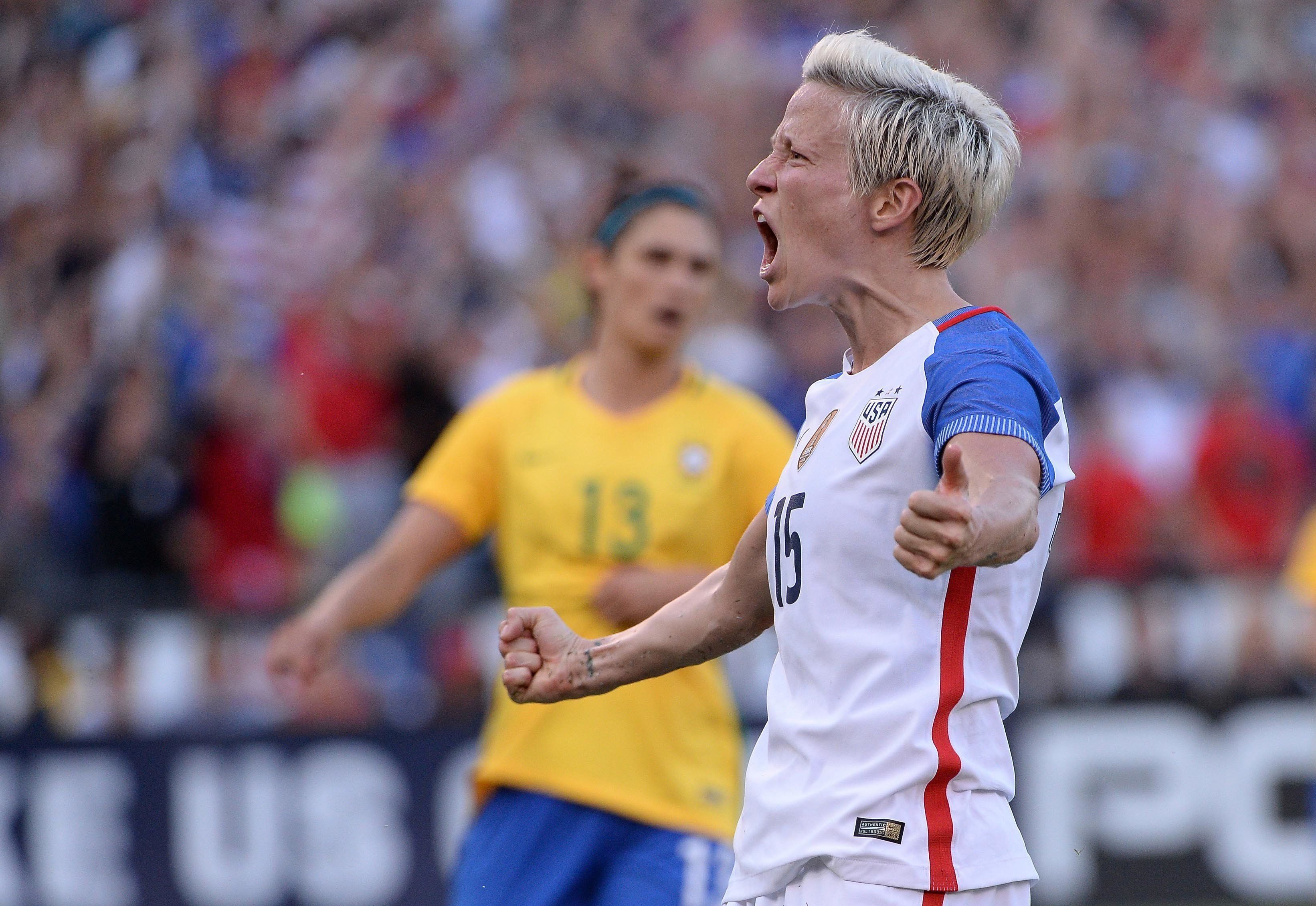 Megan Rapinoe reacts after scoring a goal against Brazil in a match last year