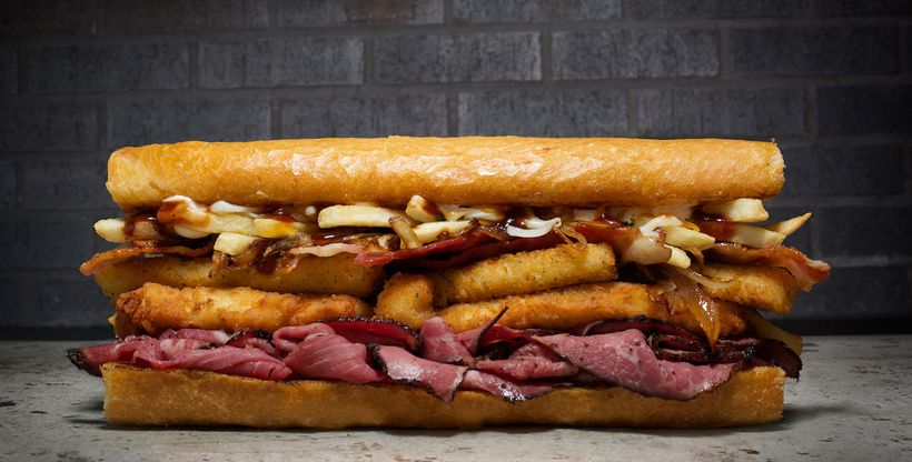 The Fat Texas with BBQ pastrami brisket, chicken fingers, mozzarella sticks, crisp bacon, grilled onions, melted cheddar and