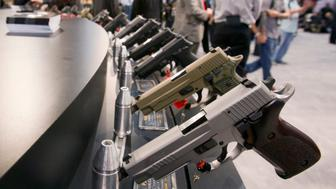Sig Sauer handguns are displayed during the annual SHOT (Shooting, Hunting, Outdoor Trade) Show in Las Vegas January 15, 2013. Gun dealers at the show are reporting booming sales resulting from worries about possible gun control legislation. REUTERS/Las Vegas Sun/Steve Marcus (UNITED STATES - Tags: SOCIETY)