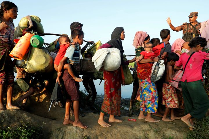 Rohingya refugees arrive to the Bangladeshi side of the Naf river after fleeing Myanmar.