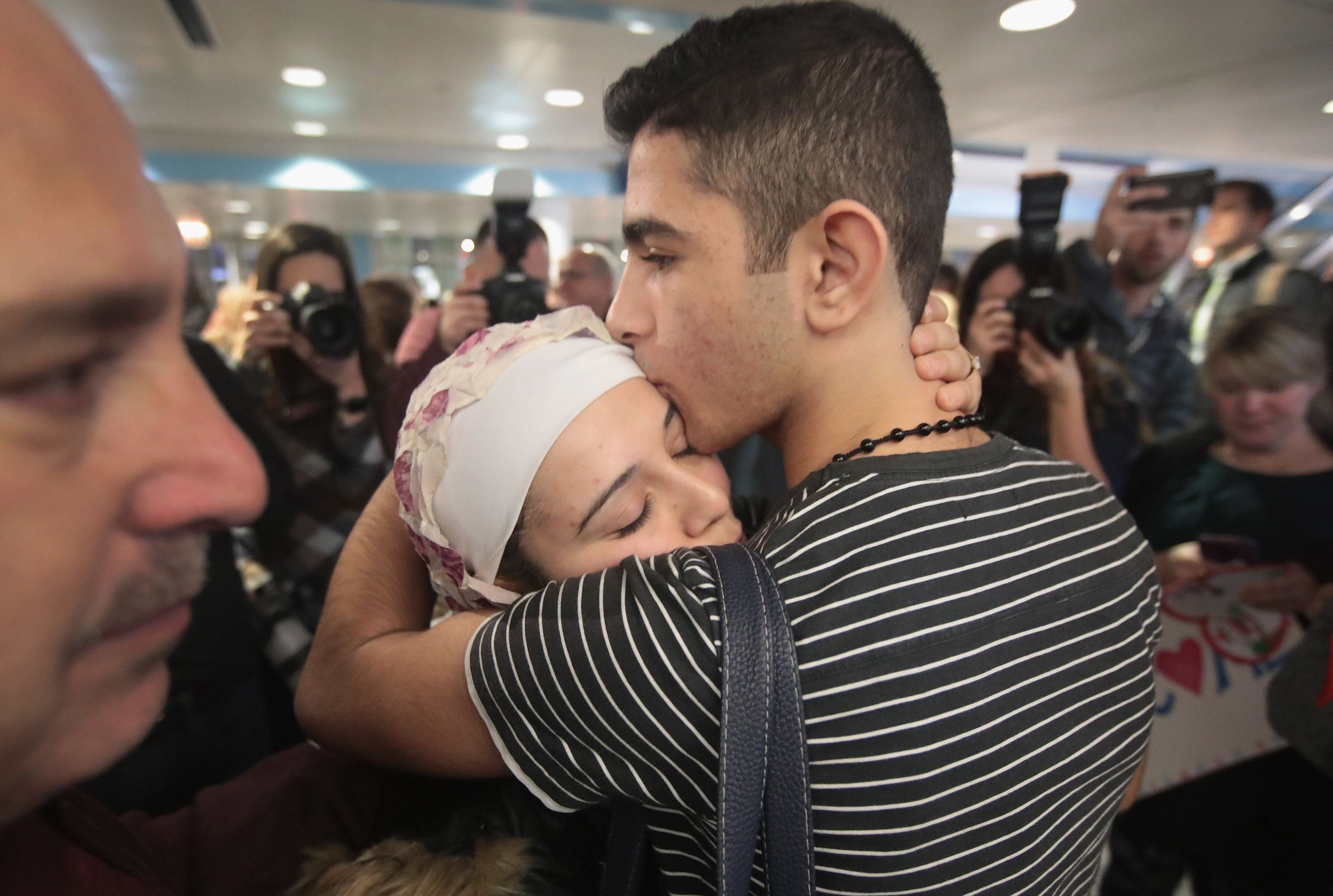 CHICAGO, IL - FEBRUARY 07:  Syrian refugee Baraa Haj Khalaf is greeted by her brother after arriving on a flight from Istanbul, Turkey at O'Hare Airport on February 7, 2017 in Chicago, Illinois. Khalaf had spent the last five years in a refugee camp in Turkey. Her trip to the United States, with her husband and young daughter, was recently suspended after President Donald Trump signed an executive order stopping Syrian refugees from entering the U.S..  (Photo by Scott Olson/Getty Images)