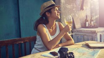 Shot of a tourist having a glass of wine while taking a break from travelinghttp://195.154.178.81/DATA/i_collage/pu/shoots/805799.jpg