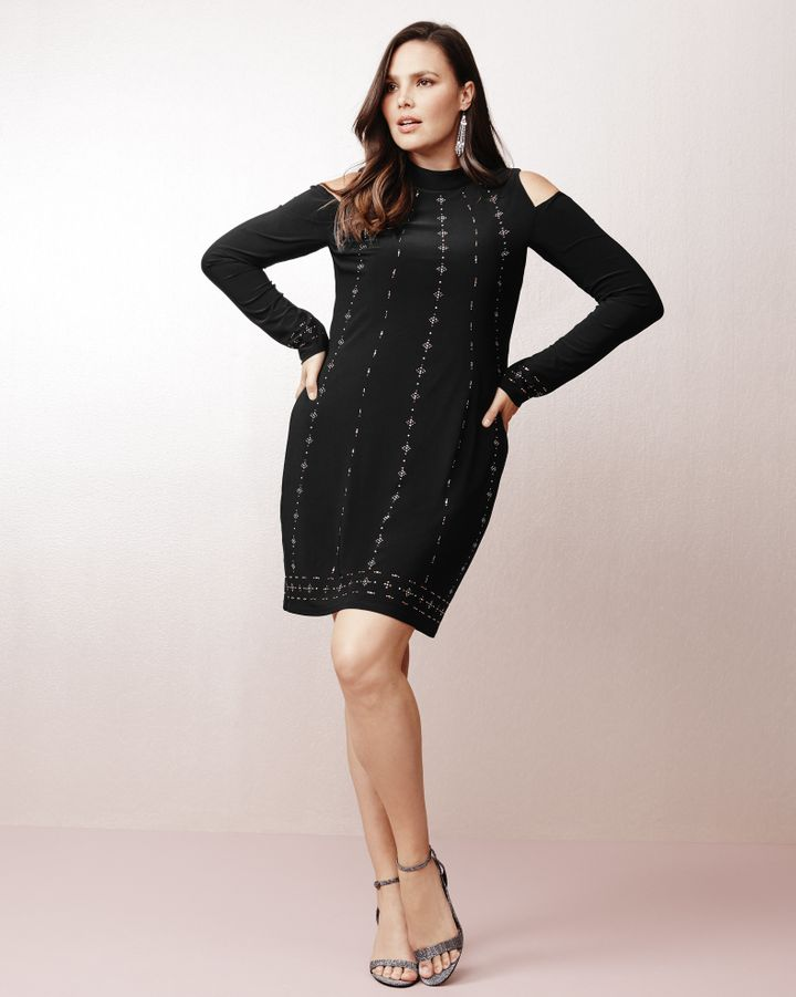 "From WHBM's new plus collection, featuring the <a href=""https://www.whitehouseblackmarket.com/store/product/plus+coldshoulder+black+knit+shift+dress/570221610?color=001&amp;catId=cat11659287"" target=""_blank"">Cold Shoulder Black Knit Shift Dress</a>.&nbsp;"