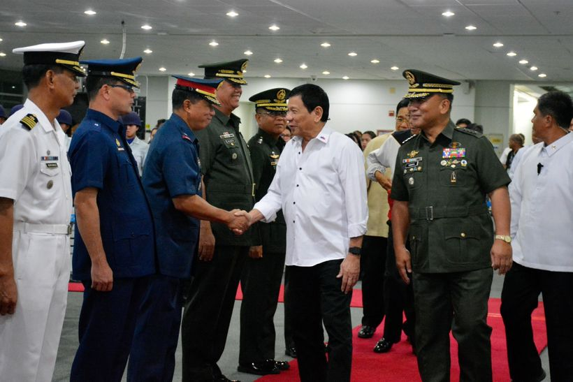 President Duterte and security officials in Davao City