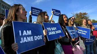 WASHINGTON, DC -OCT 20: The Trump administration is blocking a young immigrant woman in detention from accessing an abortion. Identified as Jane Doe to protect her privacy, this young woman, is in limbo as her case undergoes a hearing. A federal appeals court in has temporarily halted a judge's order requiring the federal government to allow Jane Doe to get an abortion. This morning, the Planned Parenthood Federation of America and coalition partners protested (that's Georgeanne Usova of the ACLU at left) together outside the Department of Health and Human Services in support of Jane Doe to have an abortion. (Photo by Michael S. Williamson/The Washington Post via Getty Images)