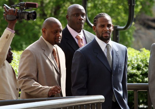 R. Kelly arrives at his child pornography trial in