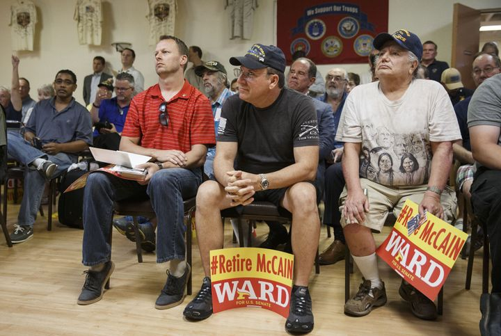 Veterans listen as Kelli Ward speaks during a campaign stop at the Veterans of Foreign Wars Post 720 in Phoenix on Aug.&