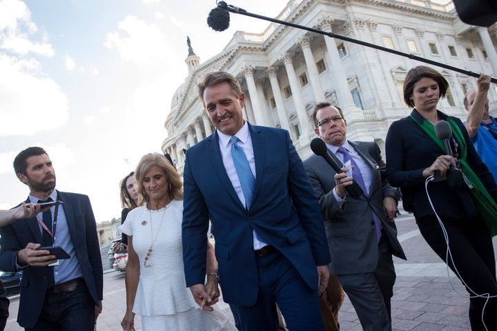 Sen. Jeff Flake (R-Ariz) and his wife Cheryl Flake leave the U.S. Capitol after he announced he will not be seeking reelectio