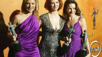Sex in the City actresses, from left to right; Kim Cattrall, Cynthia Nixon and Kristin Davis hold their awards for the Best Cast in a television drama, during the Screen Actors Guild Awards in Los Angeles.