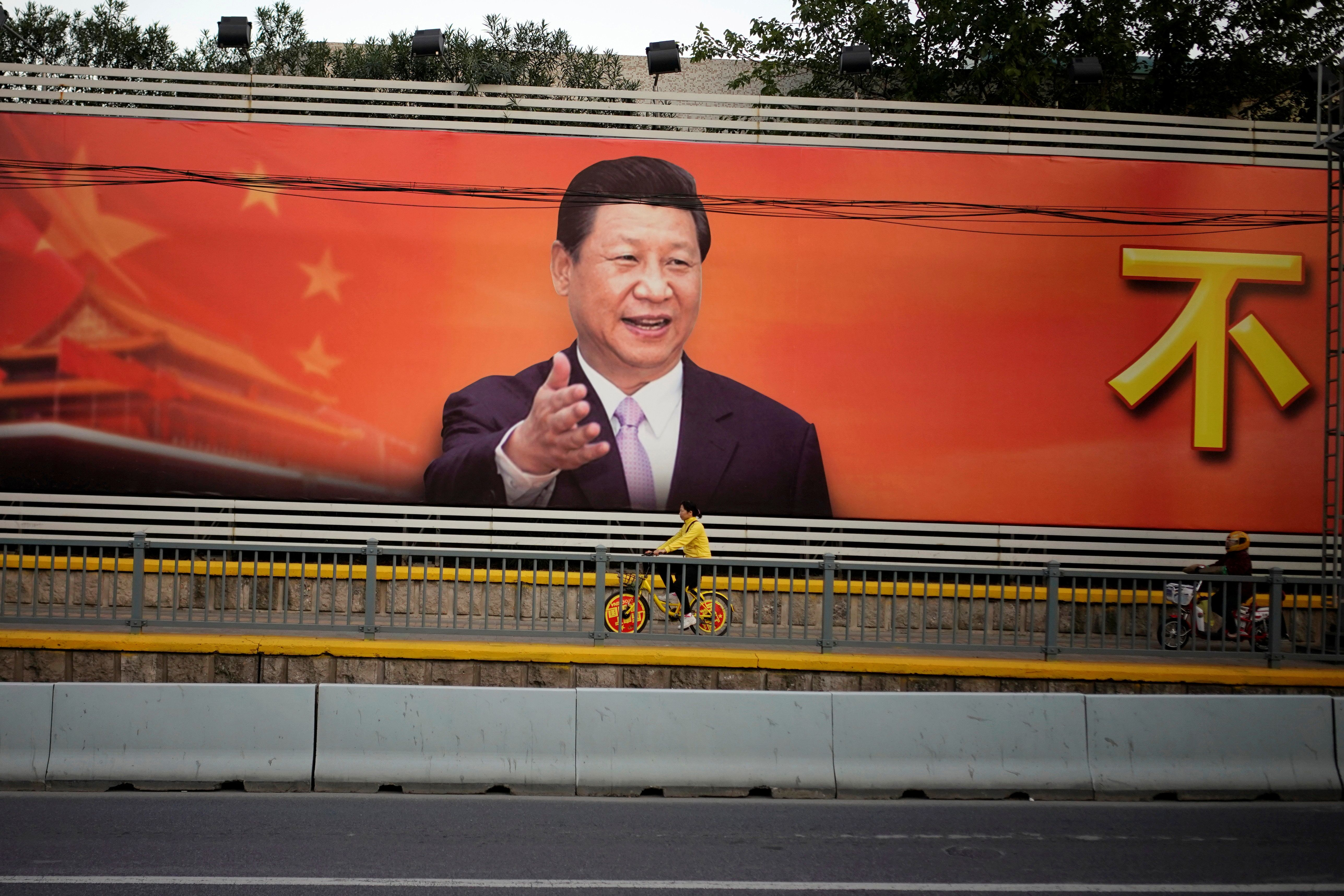 A poster with a portrait of Chinese President Xi Jinping is displayed along a street in Shanghai, China, October 24, 2017. REUTERS/Aly Song