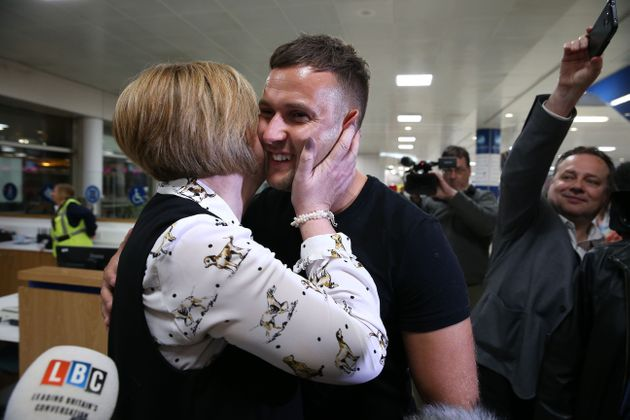 Jamie Harron with his mother Patricia after arriving at Glasgow