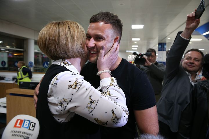 Jamie Harron with his mother Patricia after arriving at Glasgow Airport.