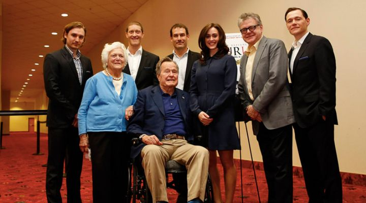 """Lind, center, said the former president """"touched"""" her twice during this photo opp and that former first lady Barbara Bush was aware."""