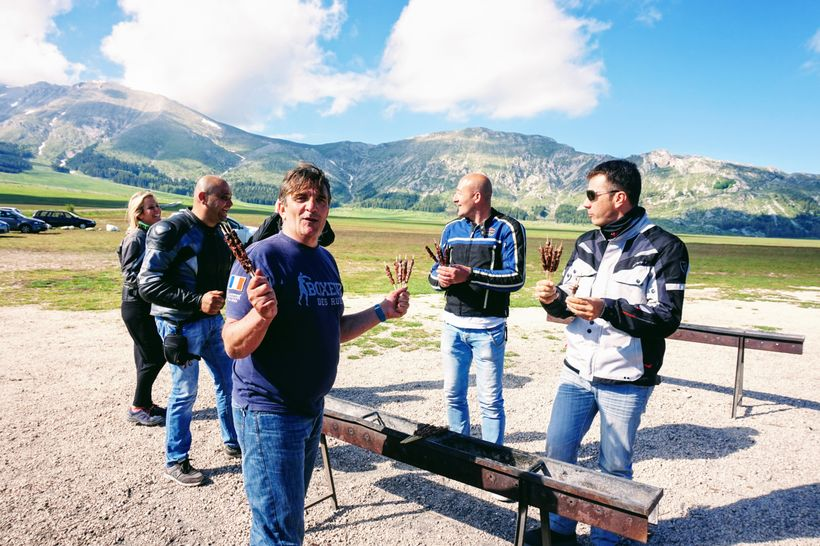 Bikers enjoying arrosticini at Ristoro Mucciante in Gran Sasso e Monti della Laga National Park