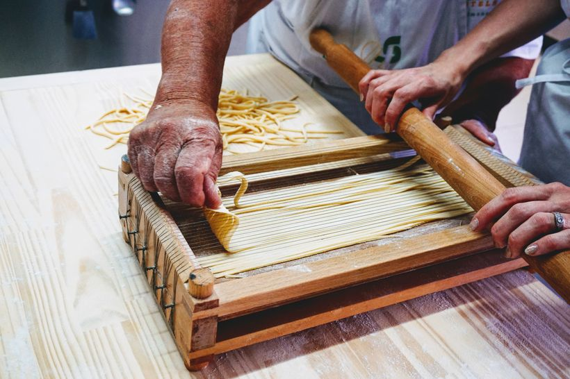 Making pasta alla chitarra at a cooking class in Sulmona