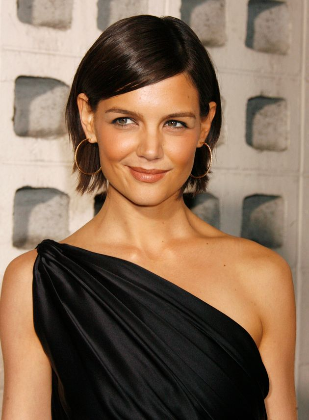 Katie Holmes poses as she arrives for a screening of a film at the opening of the AFI Fest 2007 film...