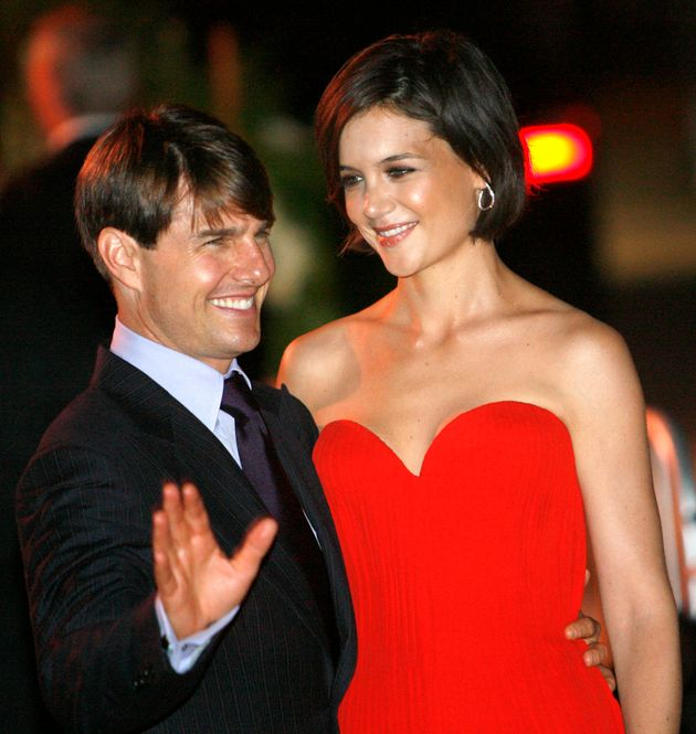 Tom Cruise and Katie Holmes pose at a party at the Museum of Contemporary Art in Los Angeles on July...