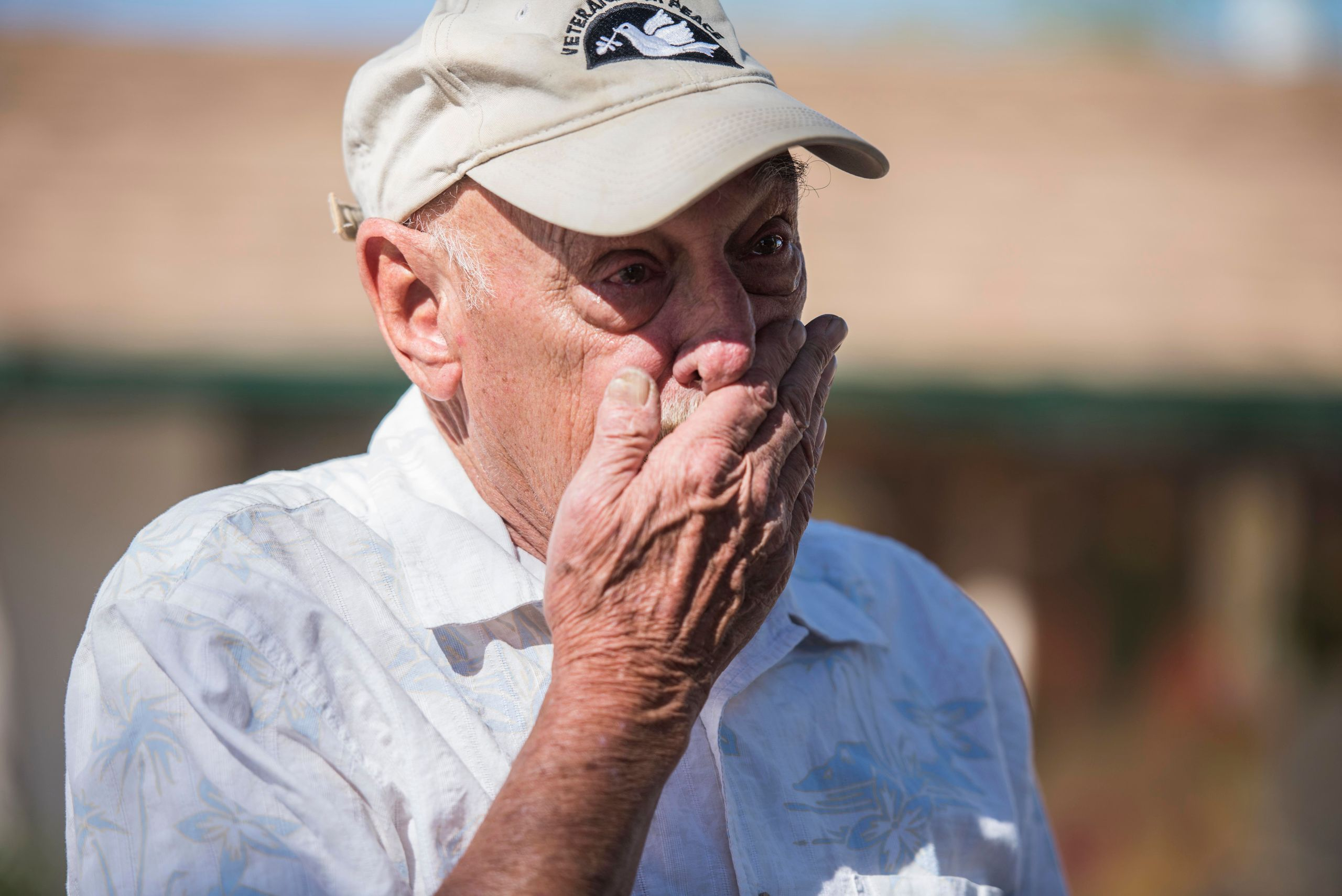 Dan Kelly,a 72-year-old Vietnam veteran, cries while explaining the humanitarian crisis on the border of the U.S. and M