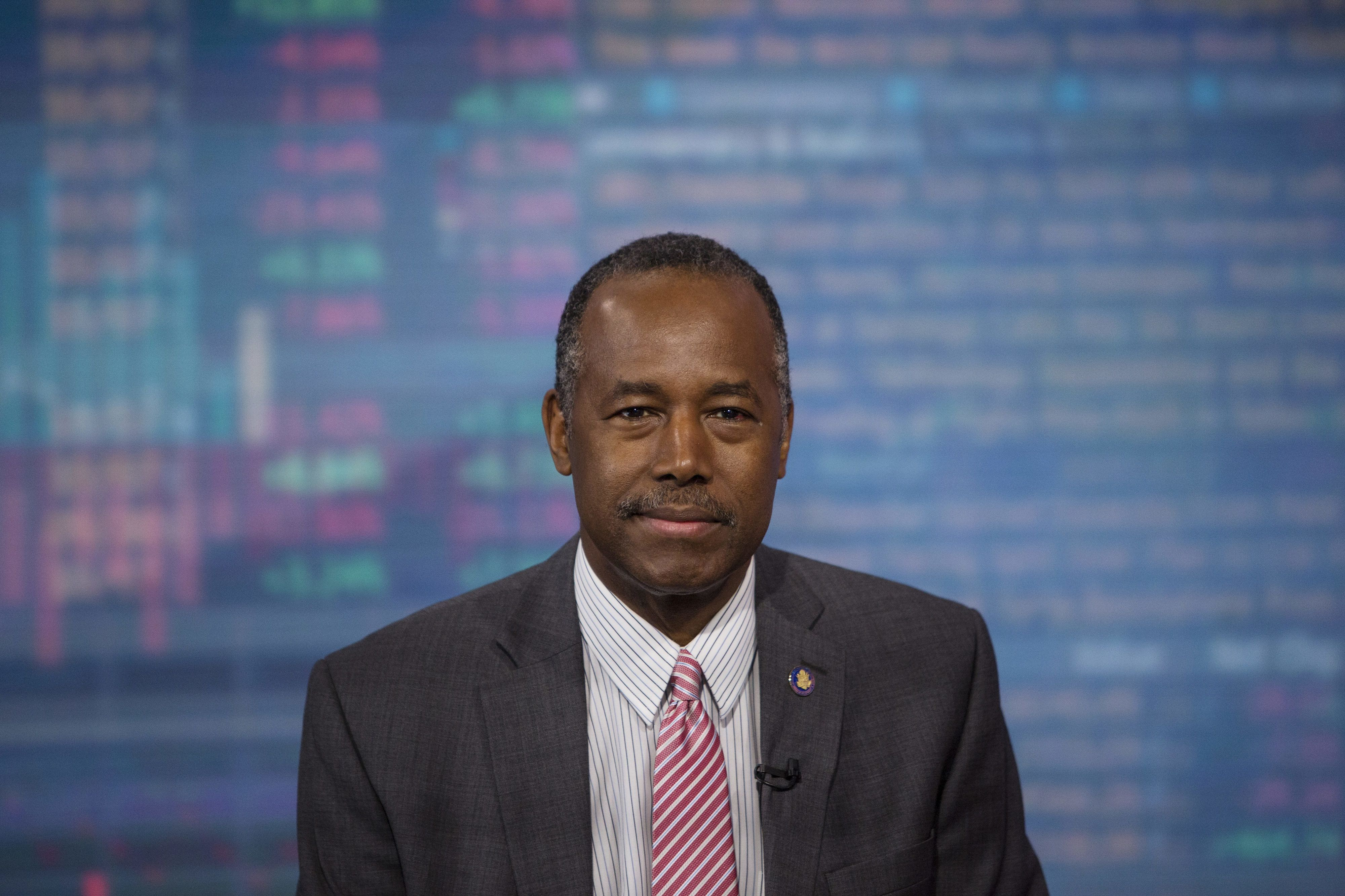 Ben Carson, secretary of Housing and Urban Development (HUD), smiles during a Bloomberg Television interview in New York, U.S., on Tuesday, June 13, 2017. Carson discussed ideas being developed to open up home ownership in the United States with a focus on millennials burdened with student debt. Photographer: Victor J. Blue/Bloomberg via Getty Images