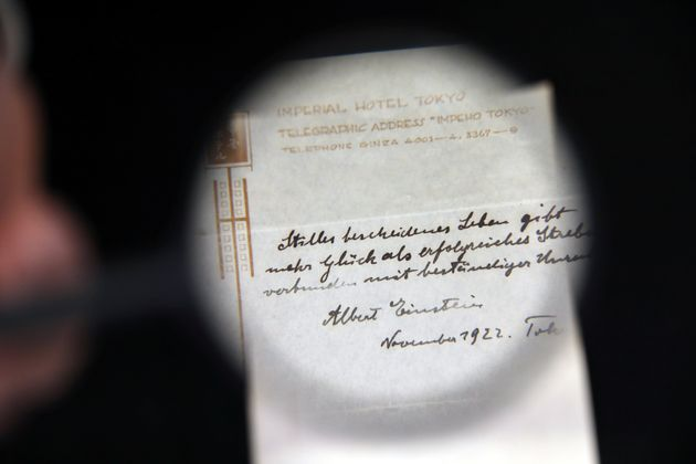 A note he hastily scrawled to a bellboy in Tokyo has sold at auction for