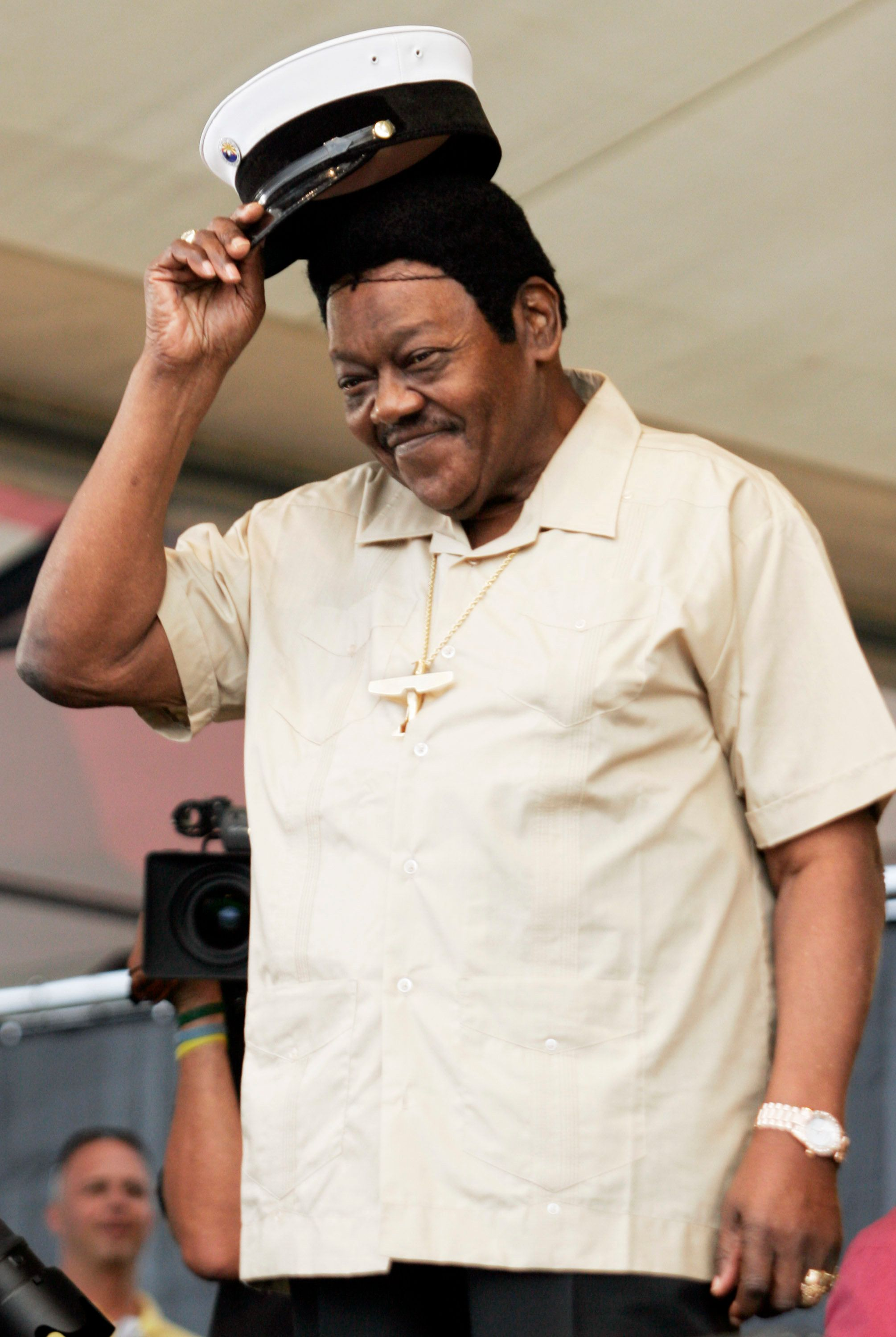 U.S. musician Fats Domino tips his hat to the crowd during the New Orleans Jazz and Heritage Festival in New Orleans May 7, 2006. Domino cancelled his performance at the festival due to medical problems. REUTERS/Lee Celano