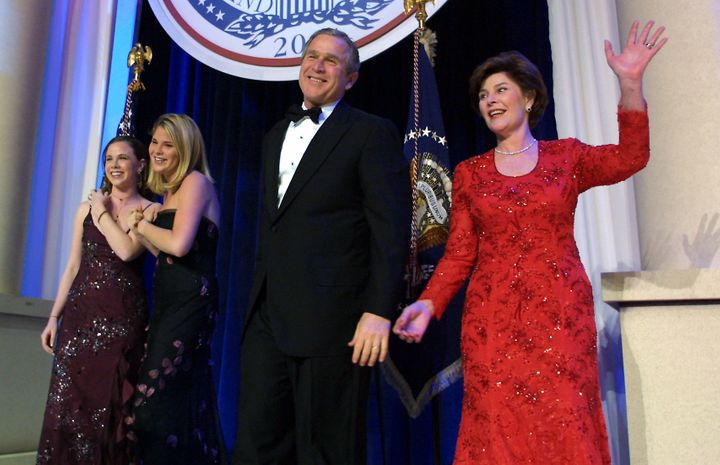 United States President George W. Bush (C), his wife Laura, and daughters Jenna and Barbara, attend the first inaugural ball